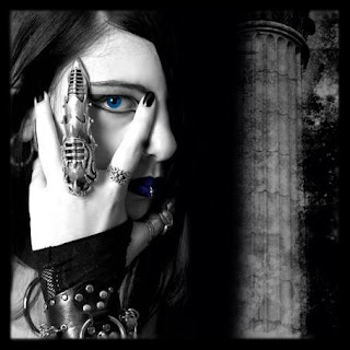 gothic girl singer with finger armour