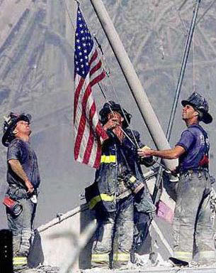 9-11_firefighters_w_flag.jpg