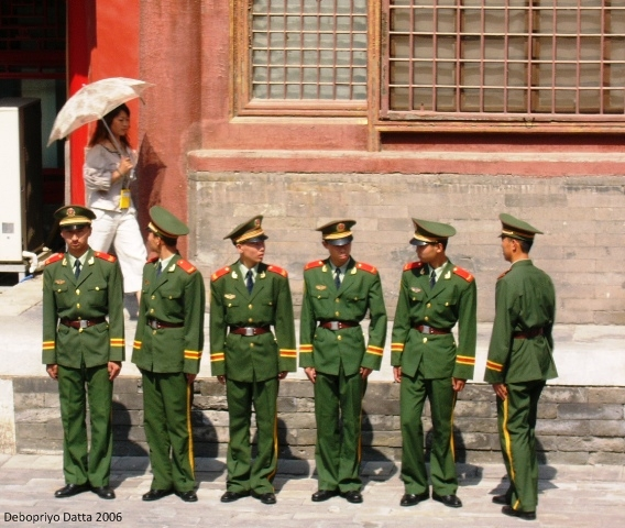 These characters were to guard the visiting dignitary (possibly Condi Rice) at the Forbidden City in Beijing. September 2006