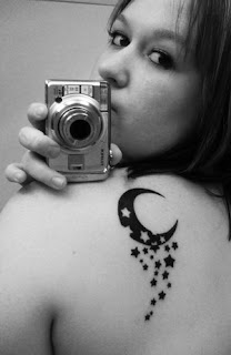 Amazing Upper Back Women Star Tattoos Picture 3