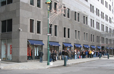 The TKTS / TDS line for cheap Broadway tickets downtown at the corner of John and Front streets in New York City
