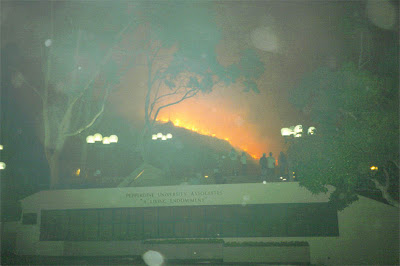Picture from Tyler Campus Center around the Fountain outside of Elkins Auditorium as flames burn the hillside next to the President's house.