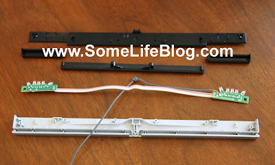 Lastly, lift out the senor bar strip and the cable from the sensor bar to complete the tear down of the Nintendo Wii Sensor Bar. Remember the the cable has a knot in it (odd) to hold the cable correctly in place and that the senor bar cable goes underneath the sensor bar strip when reassembling.