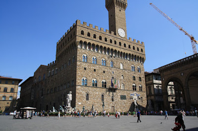 Palazzo Vecchio in the afternoon sun where the replica of the David stands.