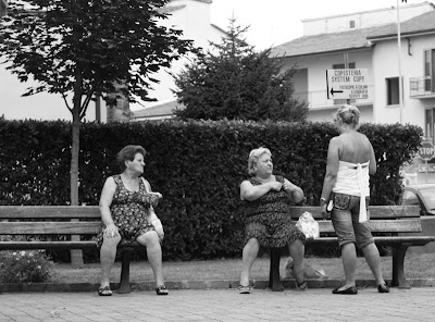 Ending the day back at our bus stop in Casellina, a few Italian women chat just after the rain has stopped.
