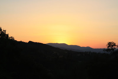 The sun sets over the hills of Florence.