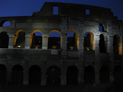 We took the last tour bus of the evening to check out all the sights in the night lights.  Here was a quick photo snapped over the Coliseum.