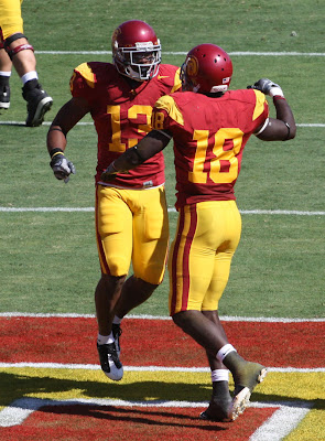 Stafon Johnson #13 greets Damian Willams #18 to celebrate the touchdown.