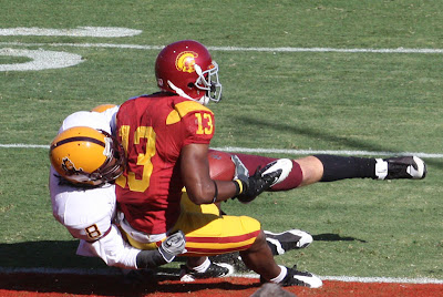 Stafon Johnson rolls into the end zone while being tackled for a USC touchdown.