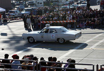 The 120th Annual Rose Parade is underway with an old Pasadena Police department car leading the way.  The theme this year was Hats Off to Entertainment -- a fun theme.