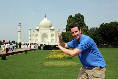 One of the many typical poses people take.  Definitely a tourist.