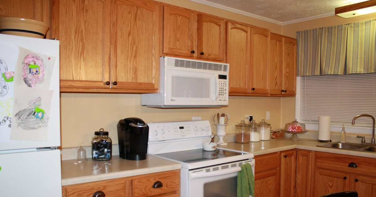 Simply stafford spray painting kitchen cabinets for Can spray paint kitchen cabinets
