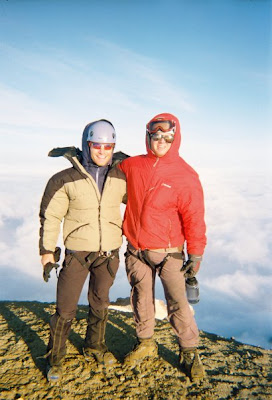 Aaron Fanetti standing on the summit of Mount Baker.
