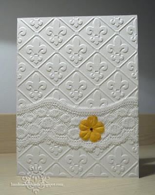 wedding card with lace, fleur de lis texture and ecru flower