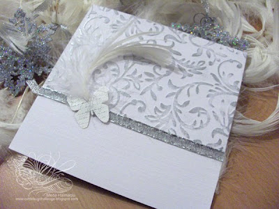 christmas invitation with butterflies an feathers