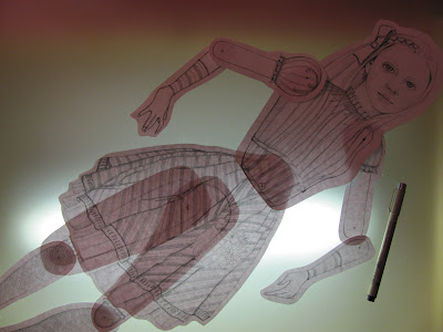 light table view of assembled paper doll