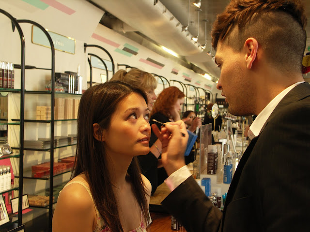 Le Métier de Beauté make-up artist Ivan Castro applies eyeshadow as liner