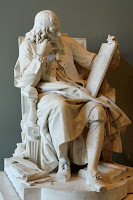 Statue of Blaise Pascal thinking and reading