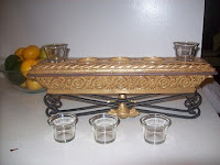 Empty glass candleholders in the front