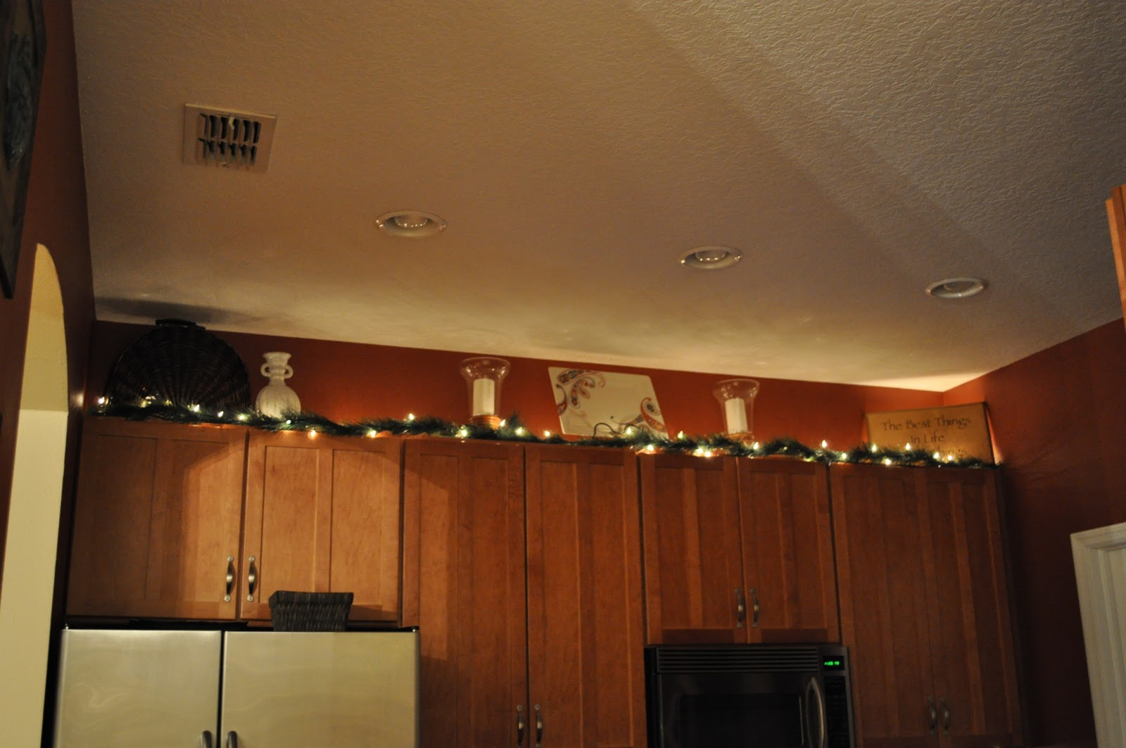 In the kitchen, I just added some lighted garland above the cabinets