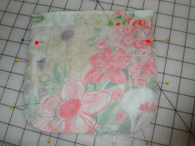 Fold the interfacing down and out of the way. Fold the top edge of
