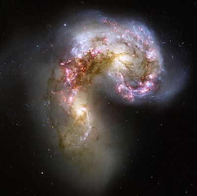 Bodies of stars wrestling beyond the fields we know. - The Antennae Galaxies, by NASA, ESA, and the Hubble Heritage Team - public domain.