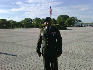 'Super hero' Carlton Anthony Williams volunteered to deploy to Iraq before he became a U.S. Citizen on July 1 at a special naturalization ceremony in the Rocket Garden at Kennedy Space Center