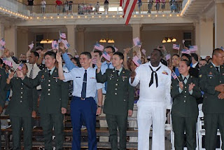 After the swearing-in, applause and waving flags
