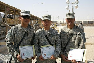 Three newly naturalized soldiers