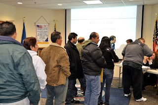 Participants wait in line to register