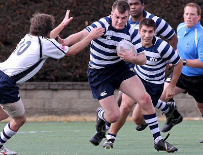 BYU Rugby 8-man Ryan Roundy punishes the Utah State defense in characteristic form