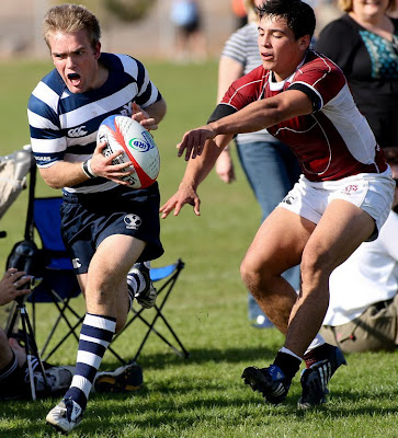 BYU Rugby Scrumhalf Shaun Davies lets out the war cry as he slips past the Texas A&M defense