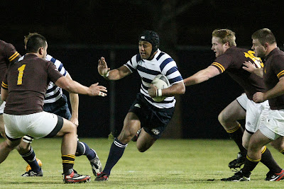 Flanker Apenisa Malani finds a hole in the Wyoming defense