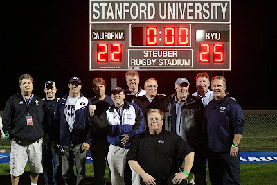 BYU Rugby Alumni join with former coach John Seggar for a scoreboard shot