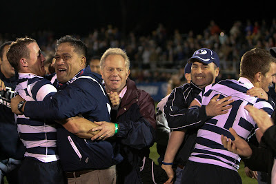 Coach Wayne Tarawhiti hugs Flanker Nate Maughan in a moment of great emotion