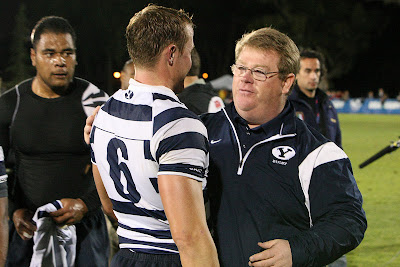 Head Coach David Smyth and Flanker Nate Maughan enjoy a moment of congratulation