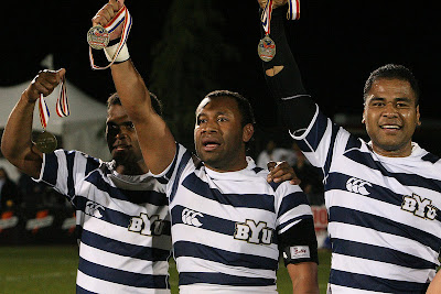 BYU Rugby players, Isi, Vito, and Pila, hoist their gold medals high