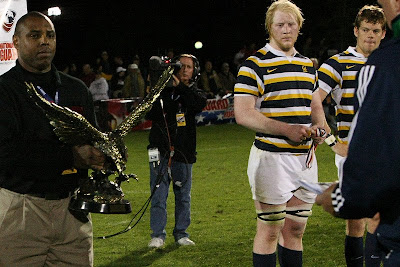Cal Rugby standouts, Eric Fry and Keegan Engelbrecht, look on as BYU receives the coveted National Championship trophy