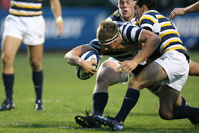 Lock Kyle Sumsion relentlessly reaches for the try, splitting two Cal defenders