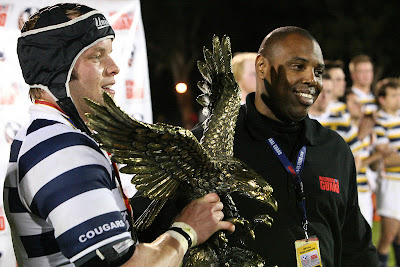 Team Captain Steve St. Pierre accepts the National Championship trophy on behalf of the BYU Rugby team