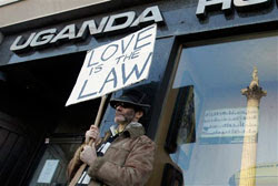 A gay rights demonstrator takes part in a protest outside the Uganda High Commission, as Nelson's Column is reflected in a window, in London, Thursday, Dec. 10, 2009    (Source:AP Photo/Matt Dunham)
