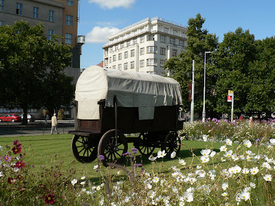 Covered wagon set up at Namesti Miru for Vinobrani