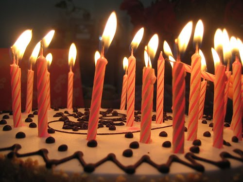Lots of candles birthday cake by dee m @ flickr