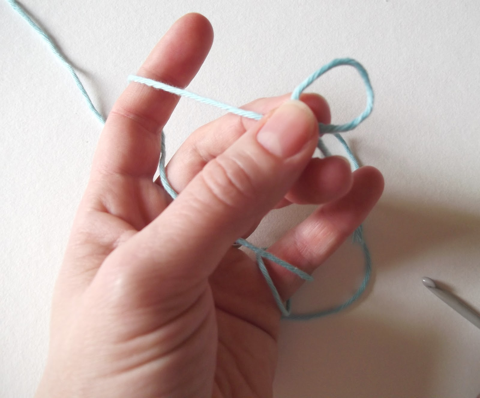 ... your fingers, then take hold of the loop between your thumb and middle