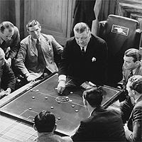 George Allison giving the Arsenal team a tactics talk