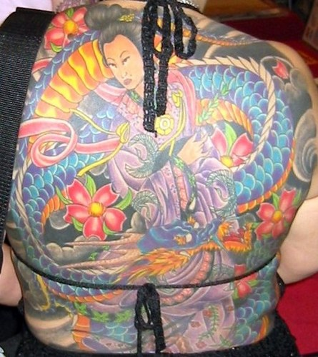 She wants to commemorate the spread with a Japanimation geisha girl tattoo