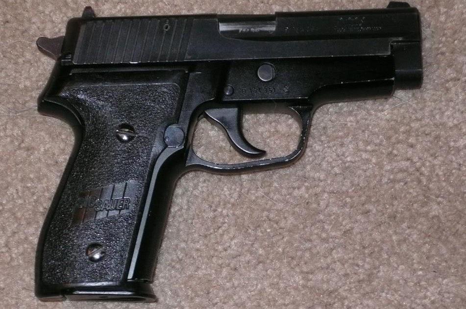 Pistola sig sauer p228 armas de fuego for Muebles para guardar armas de fuego