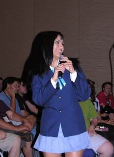 Cristina Vee (voice of Mio in the English dub of K-ON!) sings to a mildly excited crowd at the Bandai panel.