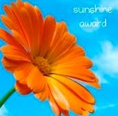 Så heldig å få en sunshine award - blir glad bare av å se på bildet!