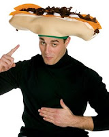 Man wearing a cheesesteak hat